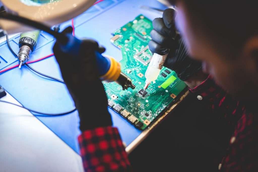 Man repairing CPU board